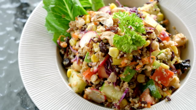 serving organic quinoa salad. - salad stock videos & royalty-free footage