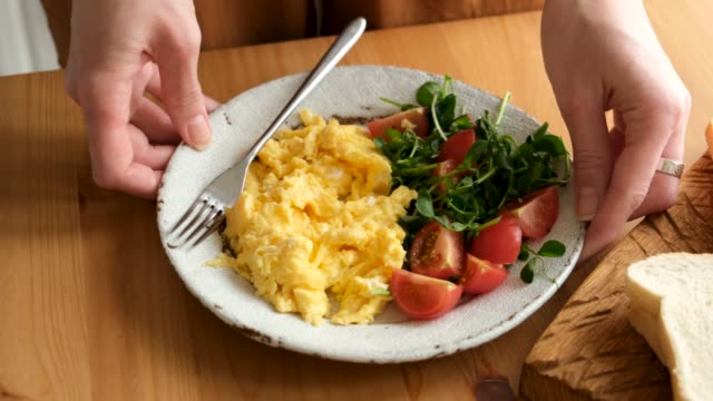 serving plate of scrambled eggs with tomatoes and arugula - breakfast stock videos & royalty-free footage