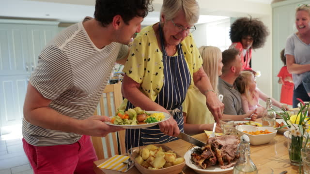 serving roast dinner! - roast dinner stock videos & royalty-free footage