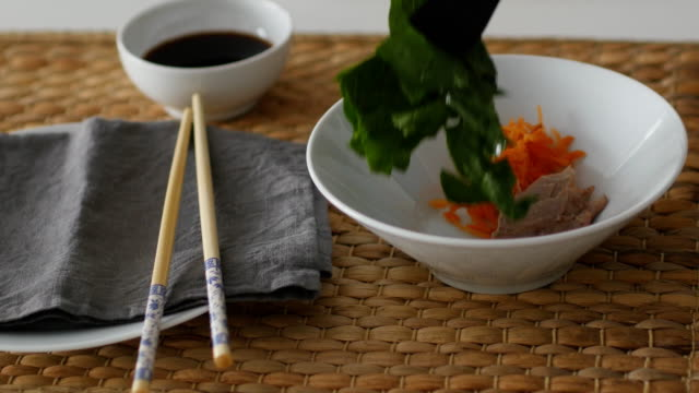 serving shiitake, duck meat and tofu soup with soy sauce on a straw mat - shiitake stock videos & royalty-free footage