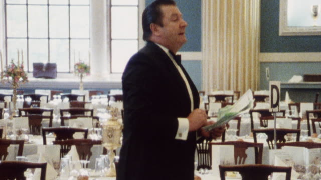 1985 montage serving staff receiving instructions and preparing for a banquet / city of london, england† - banquet hall stock videos & royalty-free footage