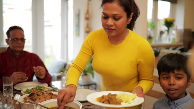 serving the family dinner - breakfast table stock videos and b-roll footage