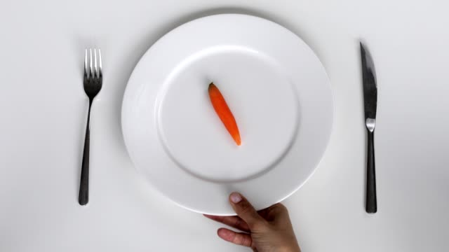 serving to one raw carrot on a plate - metal plate stock videos & royalty-free footage