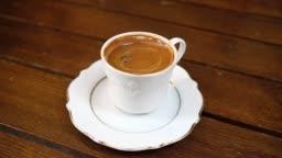 Serving traditional turkish black coffee