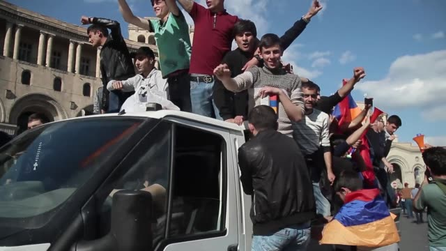 Serzh Sargsyan resigns as Prime Minister ARMENIA Yerevan EXT People riding in small truck along street as they celebrate the resignation of former...