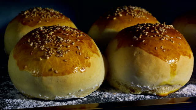 Sesame seeds buns being baked