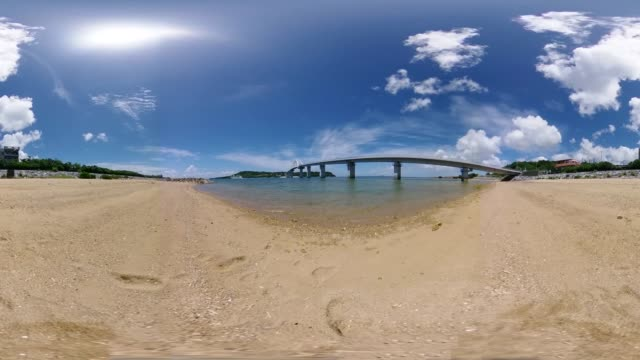 sesoko bridge and coral reef beach in okinawa - monoscopic image stock videos & royalty-free footage