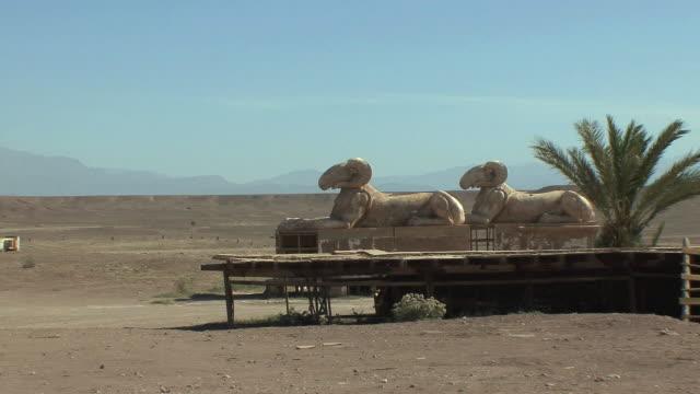 ws pan set for cleopatra movie on back lot of atlas film studios, ouarzazate, morocco - 像点の映像素材/bロール