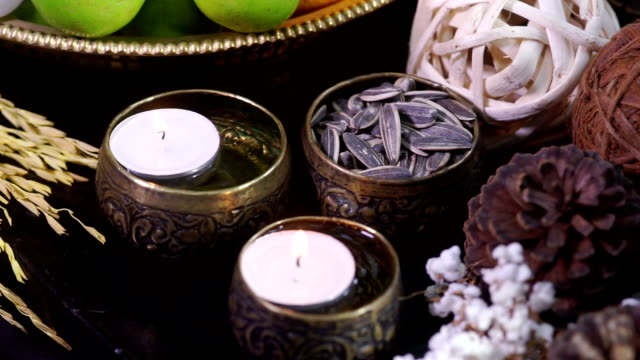 A set of herbal treatments for massage and spa decorated with set of herb and lighting candles.