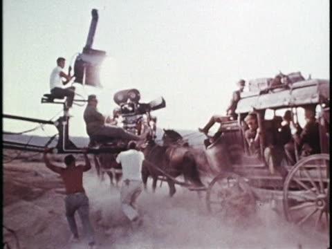 vidéos et rushes de set of 'hombre', filming a stagecoach riding in the desert. - décor de cinéma
