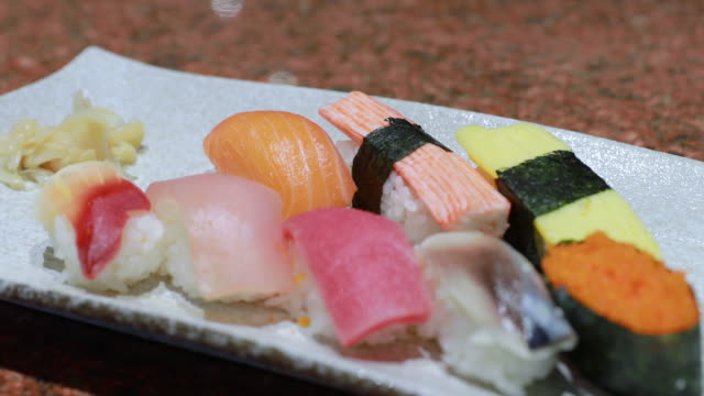 set of mix japanese sushi served on plate - sashimi stock videos & royalty-free footage