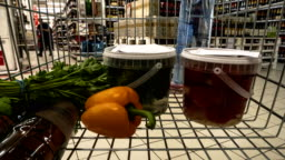 A set of traditional everyday products in the supermarket cart, time lapse,hyper lapse