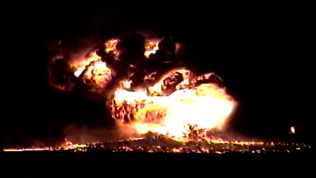 set on fire by retreating iraqi forces the oil wells emit smoke so black and thick that it almost entirely obscures the sun - oil stock videos and b-roll footage
