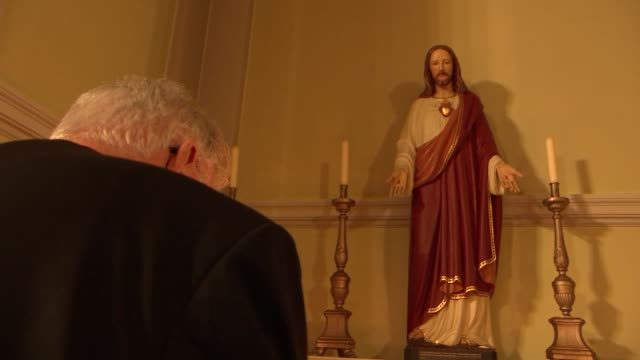 set up shots cardinal cormac murphy-o'connor; england: int set-up shots of cardinal cormac murphy-o'connor lighting candle in church and praying in... - cormac murphy o'connor stock videos & royalty-free footage