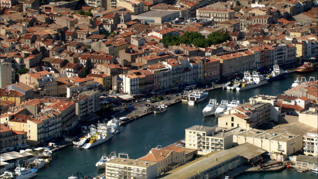 sete harbour and old town  - aerial view - languedoc-roussillon, france - france stock videos & royalty-free footage