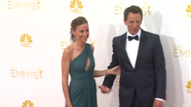 seth meyers and alexi ashe 66th primetime emmy awards arrivals at nokia theatre la live on august 25 2014 in los angeles california - エミー賞点の映像素材/bロール
