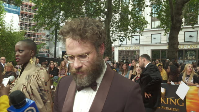 vídeos de stock e filmes b-roll de interview seth rogen on being in the film if he's got over his awe of beyonce and on being scared of singing at the lion king uk premiere on july 14... - meghan markle lion king