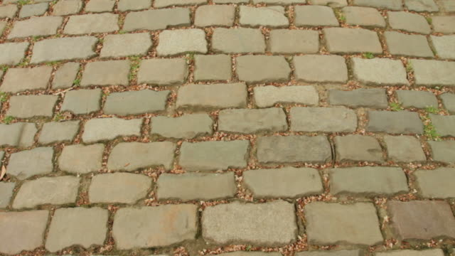 sett cobblestone, or belgian block, in paris, france - cobblestone stock videos & royalty-free footage