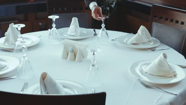 setting festive dinner table in luxury restaurant - dishcloth stock videos & royalty-free footage