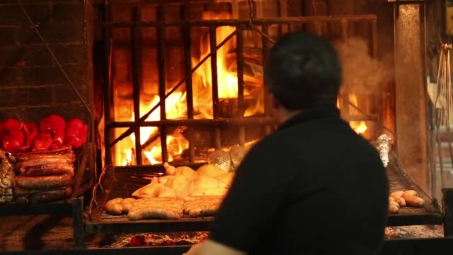 setting fire for a barbecue chorizo chicken - south america stock videos & royalty-free footage