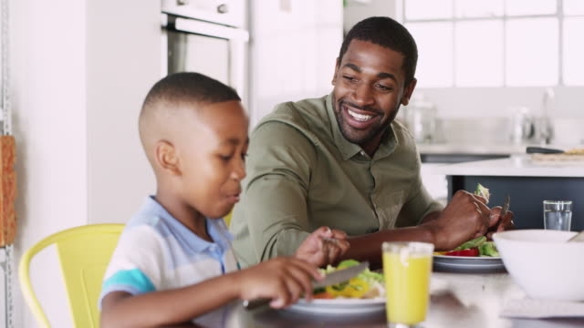 setting healthy eating standards for his son - healthy eating stock videos & royalty-free footage
