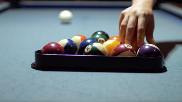 Setting pool balls before start pool game , 4k(UHD)