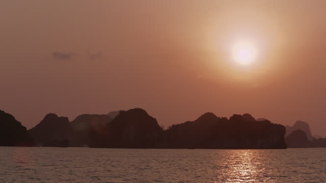 ws setting sun over ha long bay / vietnam - halong bay stock videos and b-roll footage