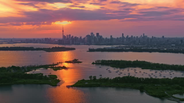 aerial setting sun shining above the city of toronto, ontario - ontario canada stock videos & royalty-free footage