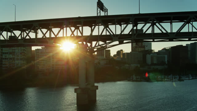 setting sun shining through marquam bridge in portland at sunset - aerial - portland oregon sunset stock videos & royalty-free footage