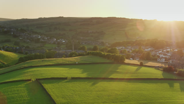 setting sunlight on haworth, west yorkshire - aerial - twilight stock videos & royalty-free footage
