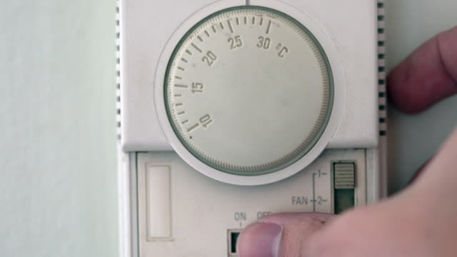setting thermostat of air conditioner - air conditioner stock videos and b-roll footage
