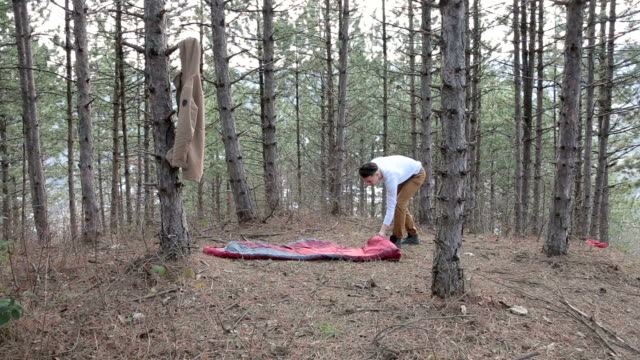 Setting up a sleeping bag in the forest