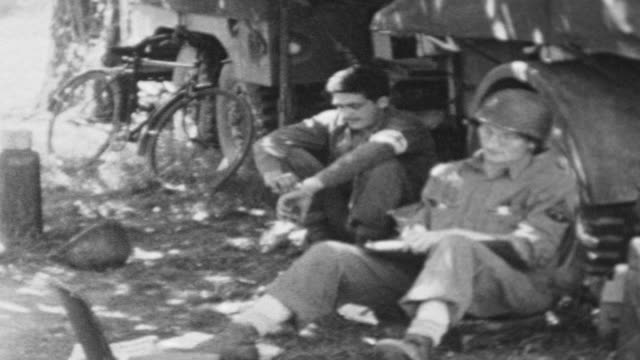 setting up camp in normandy after invasion / burning paper / medics field desk and journal writing / d-day setting up camp on june 06, 1944 in... - normandy stock videos & royalty-free footage
