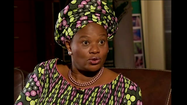 set-up shots of reporter sitting with dora akumyili dora akumyili interview sot - saying umar's father reported him to nigerian and american... - street name sign stock videos & royalty-free footage