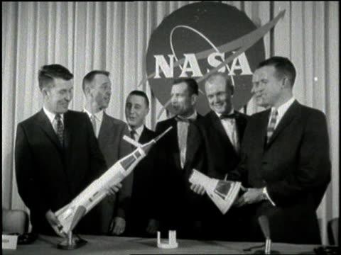 seven astronauts pose beside a model of the mercury 7. - alan b. shepard jr stock videos & royalty-free footage