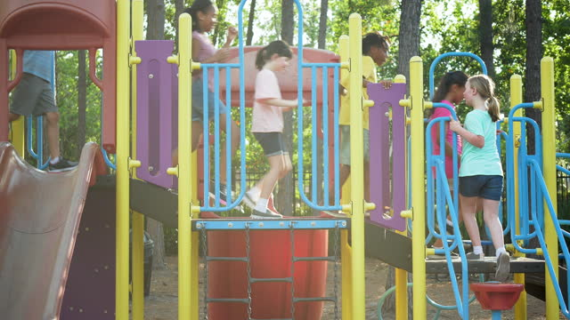 seven children climbing on playground equipment - 8 9 years stock videos & royalty-free footage