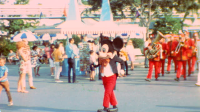 seven dwarfs / young singers at tomorrowland stage / three little pigs / jaq the mouse / mickey mouse leading the marching band / disney characters... - disney stock videos and b-roll footage