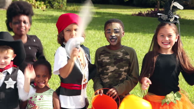seven excited multi-ethnic children in halloween costume - jack o' lantern stock videos and b-roll footage