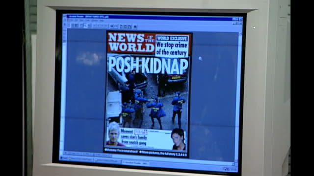 seven former news of the world journalists face phone hacking charges r03110201 3112002 int andy coulson and brooks sitting at computer with headline... - andy coulson stock videos & royalty-free footage