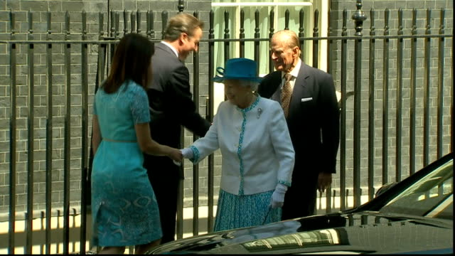 Seven former News of the World journalists face phone hacking charges Downing Street DAY David Cameron shaking hands with Queen Elizabeth II Samantha...