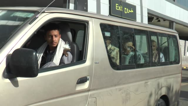 Seven members of Yemeni Popular Resistance Forces freed by Houthi forces in Sanaa arrive at Sanaa International Airport to depart for Aden in Yemen...