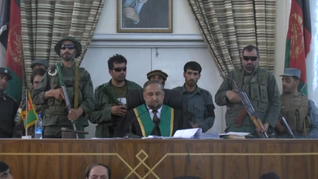 seven men who gang-raped four women on august 23, sit in court in kabul, afghanistan on september 7, 2014. afghanistan handed the death penalty to... - hinrichtung stock-videos und b-roll-filmmaterial