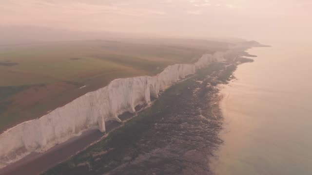 seven sisters cliffs, an iconic british landscape at sunset in south downs national park, england. high aerial drone view - number 7 stock videos & royalty-free footage