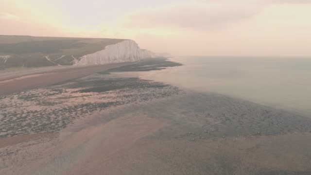 seven sisters cliffs at sunset in south downs national park, england. aerial drone view - number 7 stock videos & royalty-free footage
