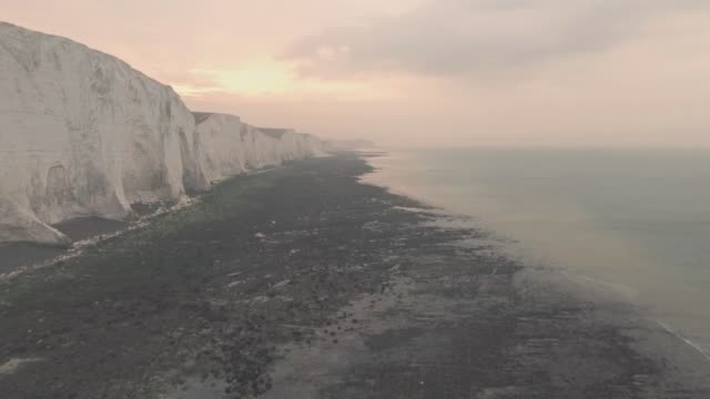 seven sisters white chalk cliffs at sunset in south downs national park, england. aerial drone view - number 7 stock videos & royalty-free footage