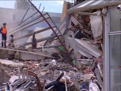 a seven story office block lies in ruins following the christchurch earthquake - カンタベリー点の映像素材/bロール