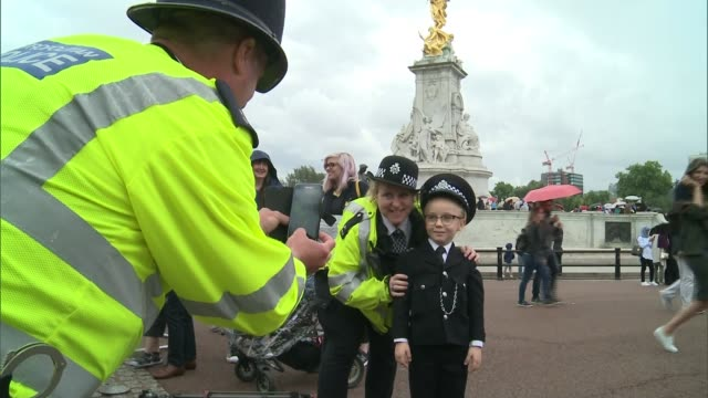 Seven year old Charlie Peebles is granted his wish of being a police officer for a day ENGLAND London EXT Charlie Peebles saying 'Ello ello ello' SOT...