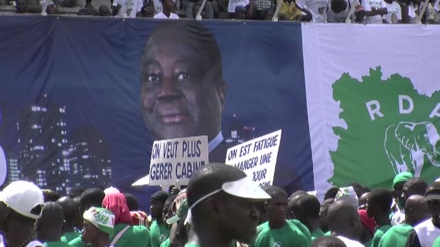 seven years after it was torn asunder by a vicious civil war ivory coast's five million voters go to the polls on sunday in a presidential election... - côte d'ivoire stock videos & royalty-free footage