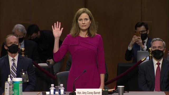 seventh circuit judge amy coney barrett raises her right hand to take the oath prior to opening statement on first day of confirmation hearings... - oath stock videos & royalty-free footage