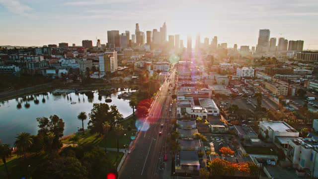 seventh street passing macarthur park in westlake at sunrise - aerial - wide shot点の映像素材/bロール